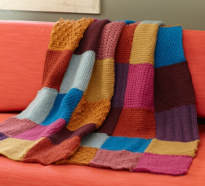 Multi-coloured blanket in crochet squares
