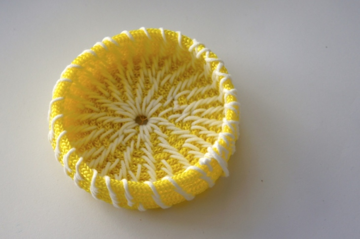 Small round basket in bright yellow and white